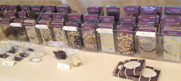 Woodhouse Chocolates' bar selection stretches along the back wall of the store.