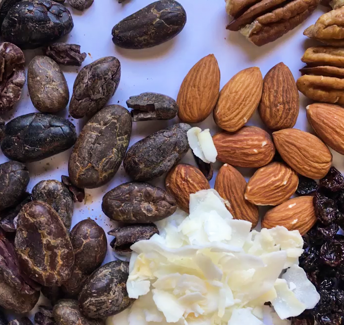 Cocoa beans, a few essential ingredients and your favorite toppings can become you own custom chocolate bar.