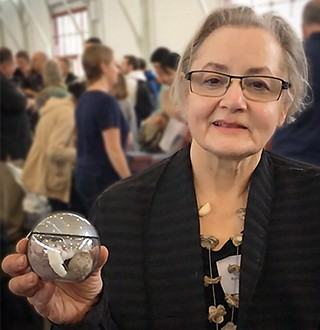 Karen Urbanik shows off flying noir's Baby Dino Egg